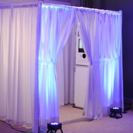 white enclosed photo booth perfect for a wedding